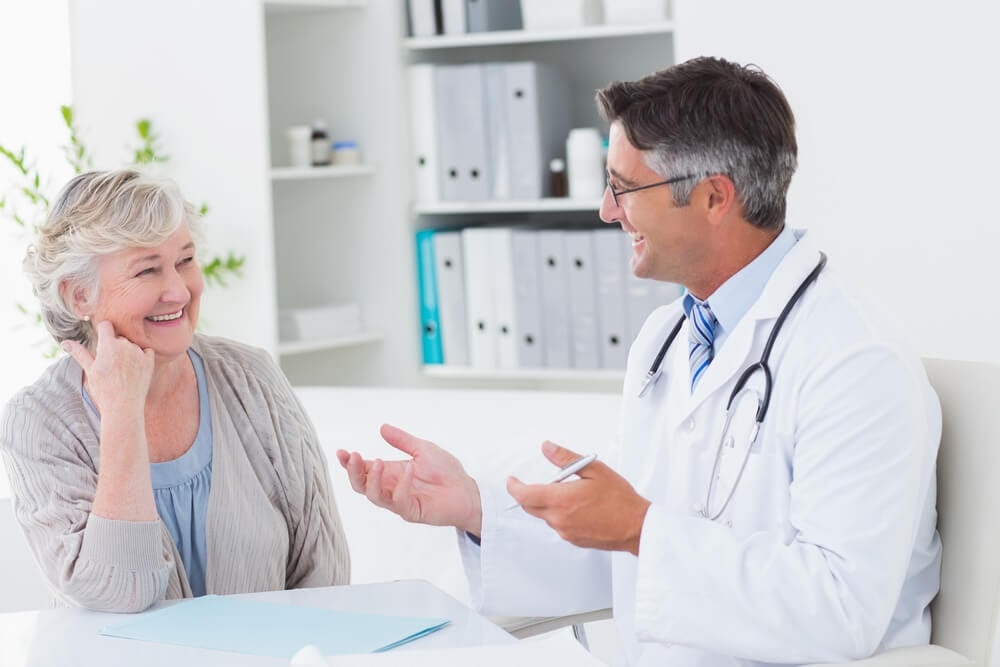 Women talking to doctor