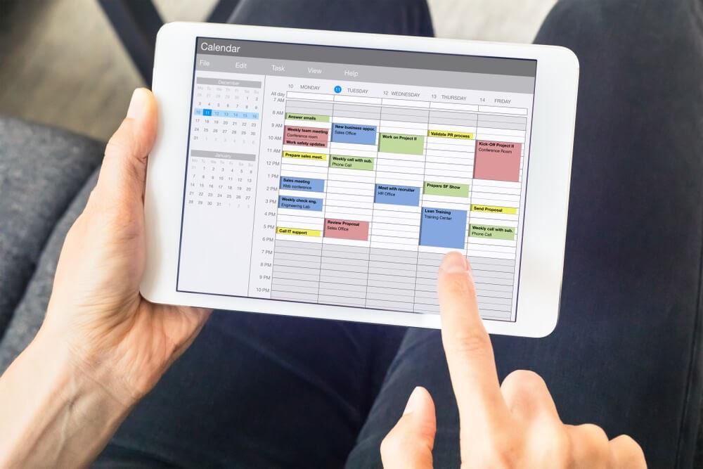 handheld tablet displaying calendar application