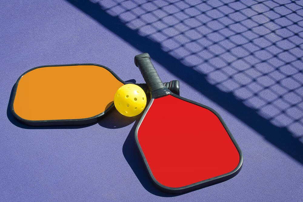 Read and orange Pickleball paddles with yellow ball