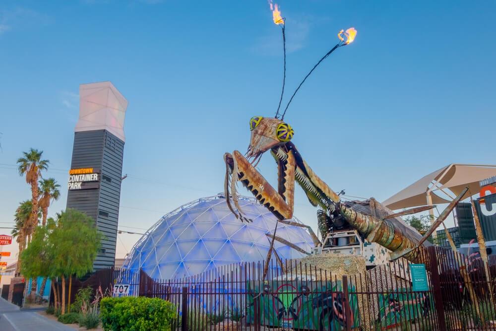 Metal praying mantis sculpture