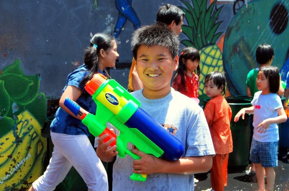 Child holding large water gun