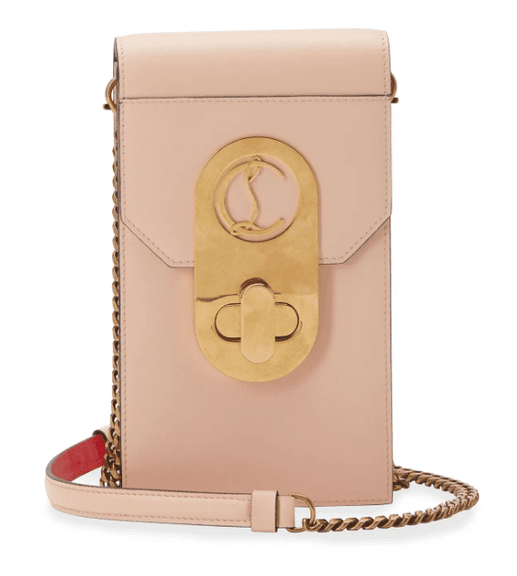 Blush colored phone case with gold shoulder chain
