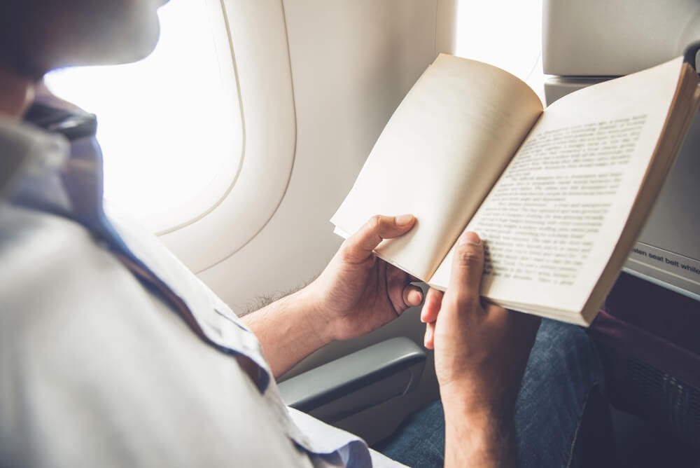 Person in airplane reading