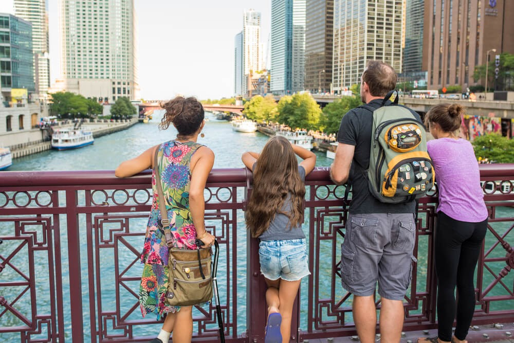 Family looks over water from bridge