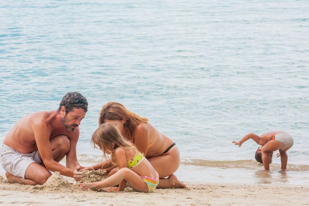 Family play on the beach
