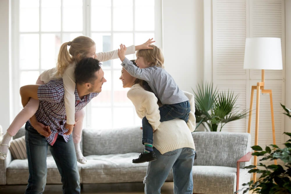 family playing in livingroom