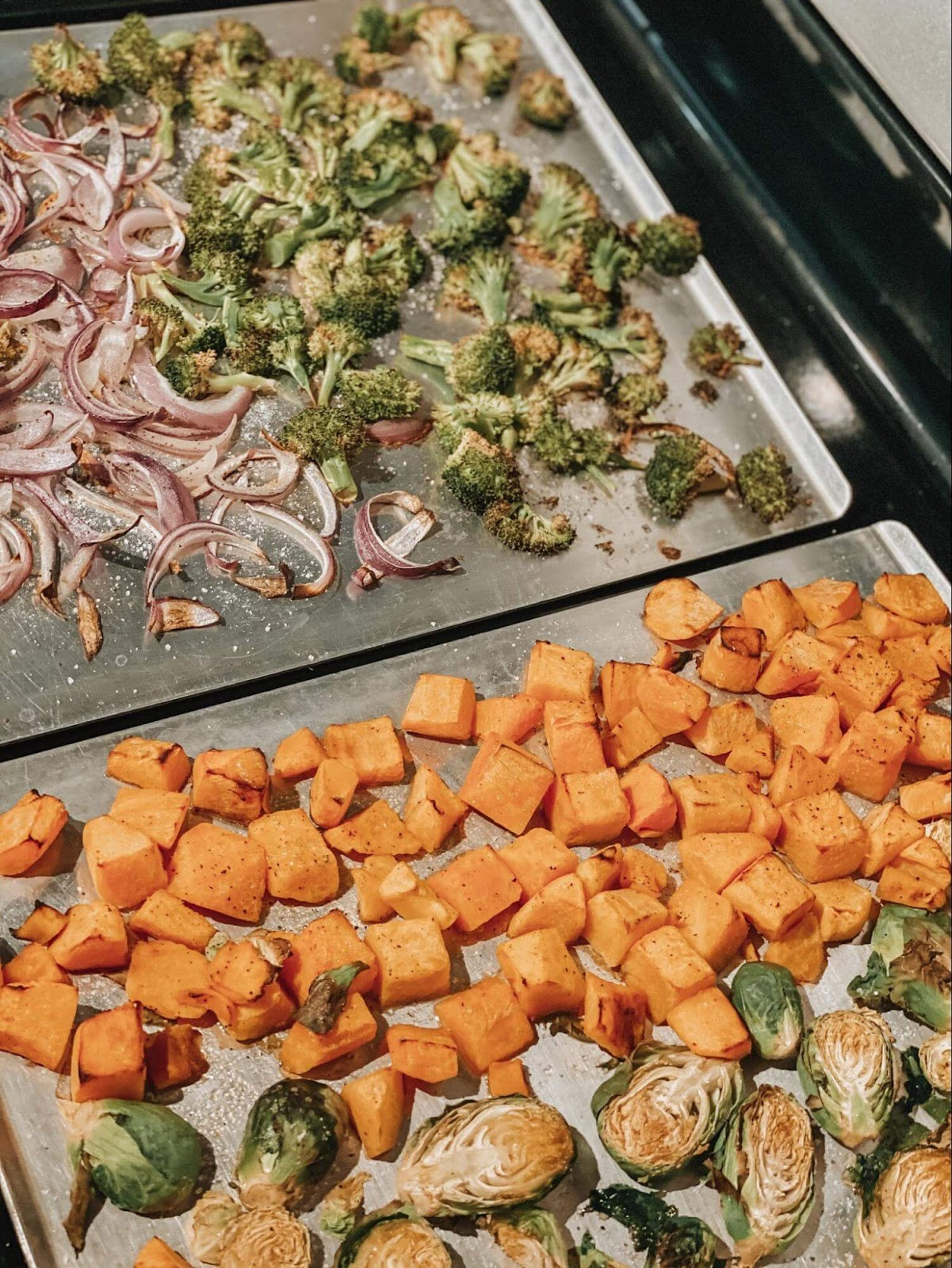 Photo of veggies roasting on a sheet pan