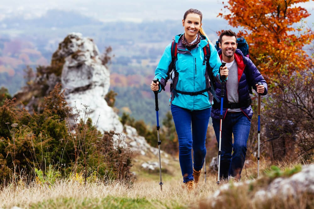 Two people hiking with backpacks