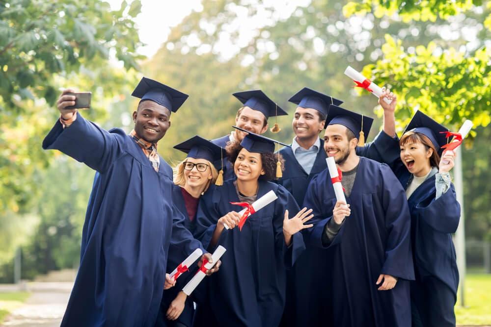 Group of graduates posing for selfie