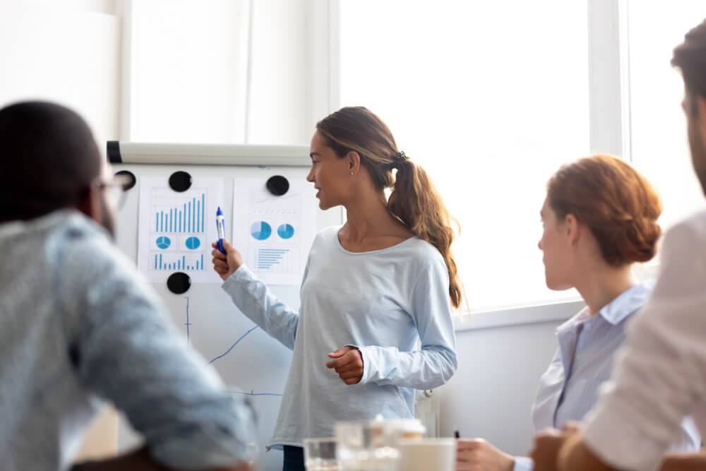 Woman giving presentation to group