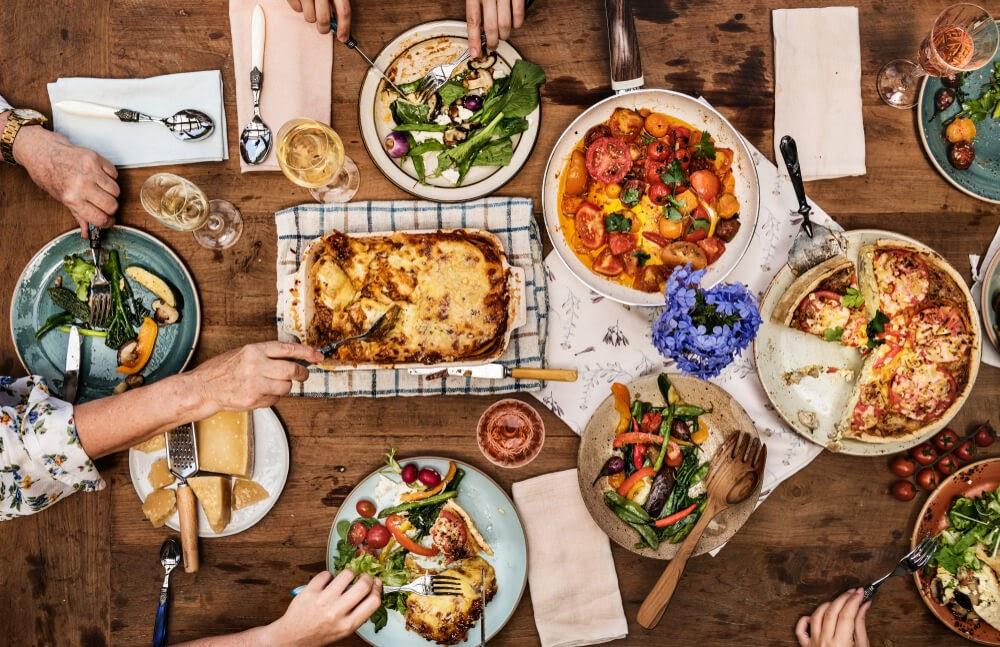 dinner table full of family style food