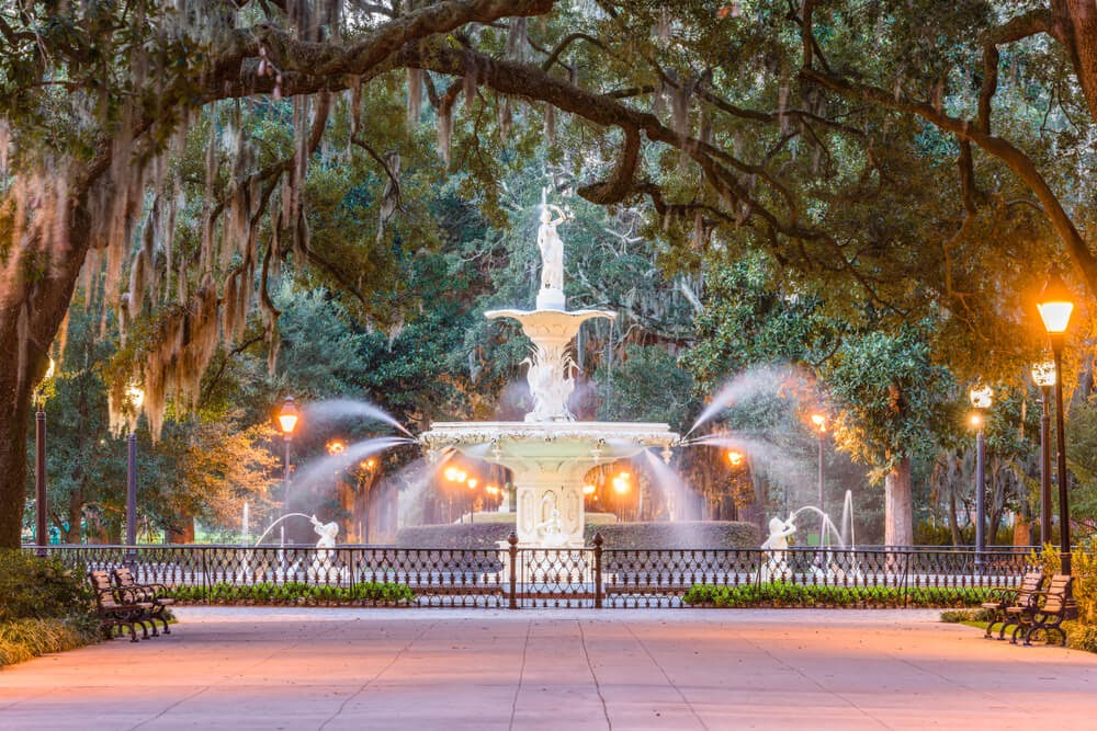 Forsyth Park fountain in Georgia. Large fountain under trees covered in moss