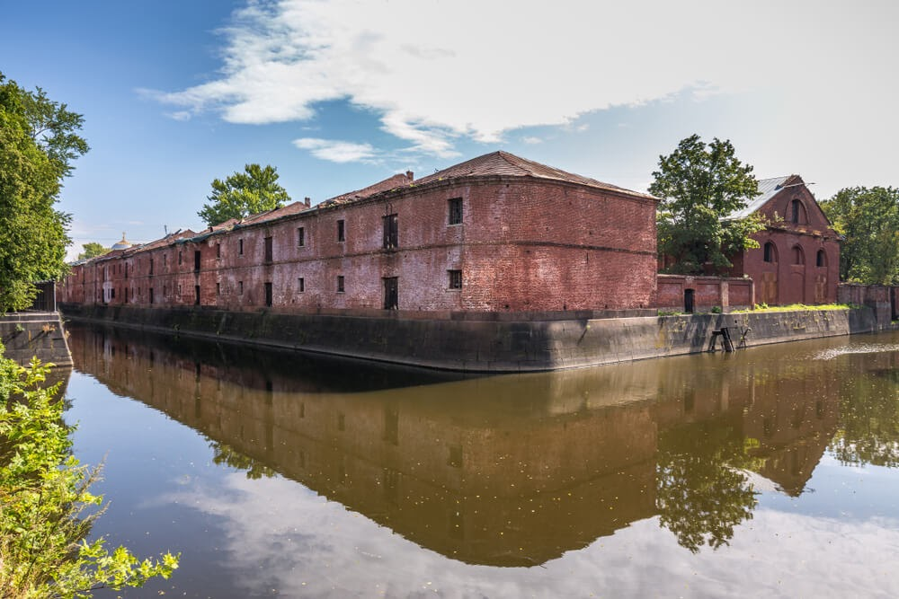 Obvodny Canal in Russia. Large brick building surrounded in water
