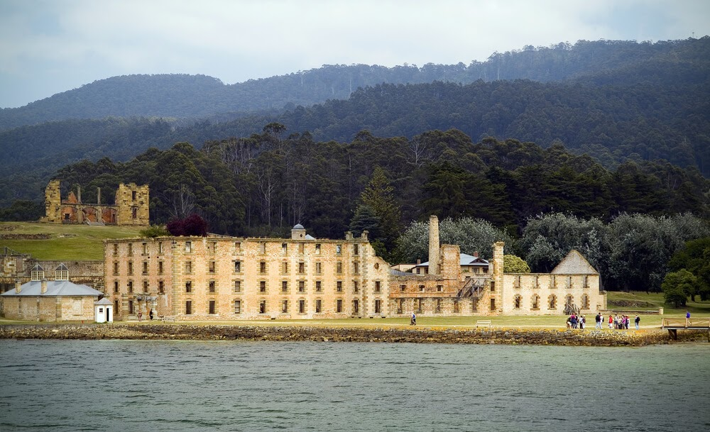 Remnants of a large golden brick building in Port Arthur, Australia.