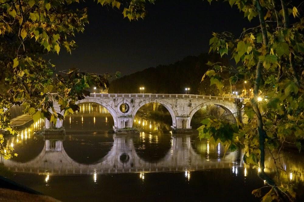 Ponte Sisto in Rome. Stone bridge photographed at night.