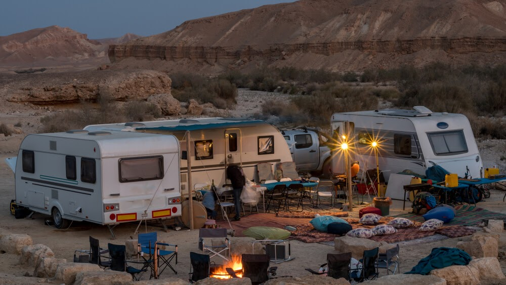 Group of RVs in the desert in the evening.