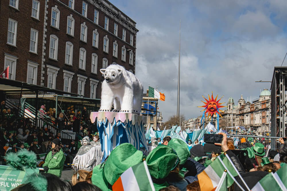 Parade in Dublin with float of polar bear on ice.