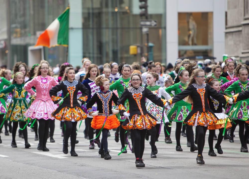 Young girls fill street in colorful Irish folk-dancing attire