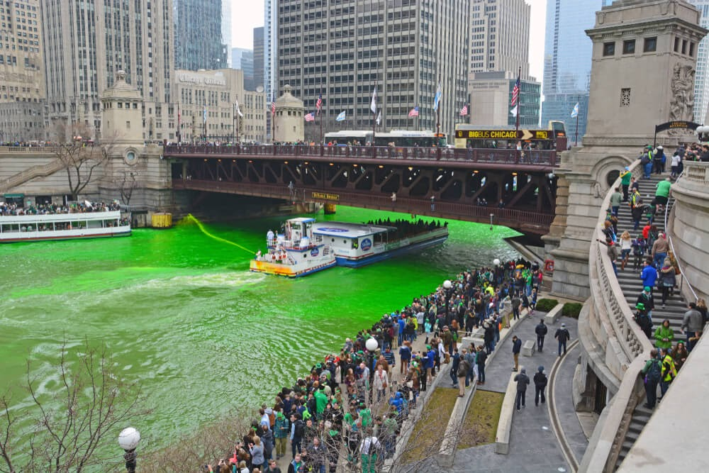 Chicago River dyed green surrounded by people