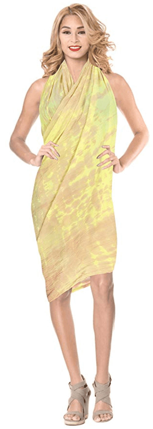 Woman modeling yellow sarong wrapped in the flyway style