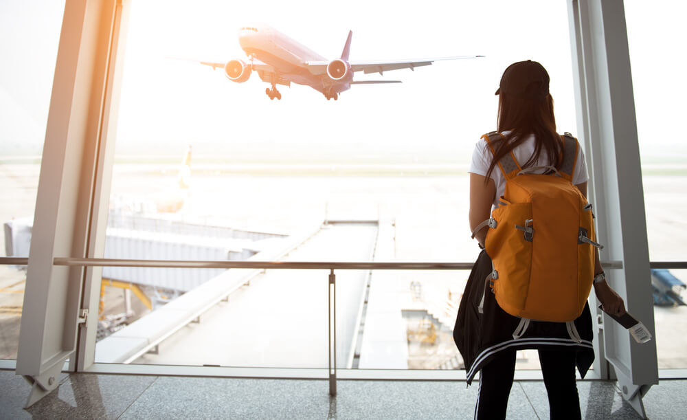 women with travel backpack