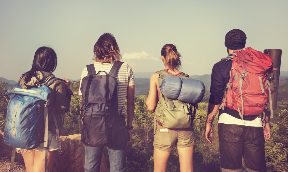 group of friends with travel backpack