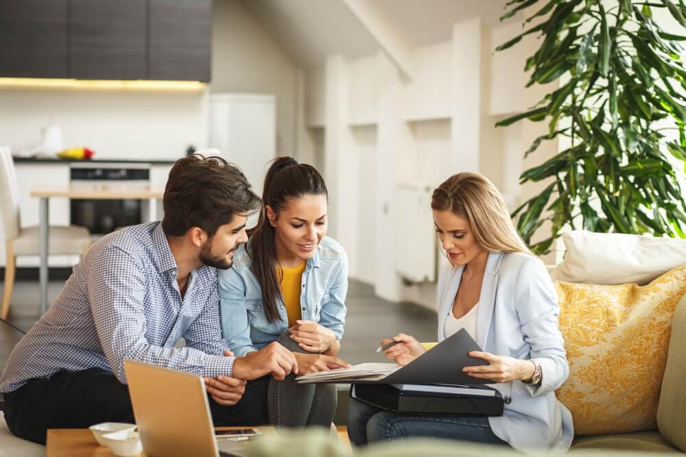 Three people looking over paperwork