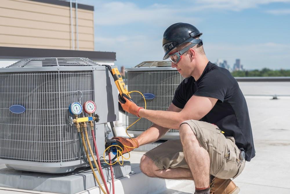 Technician repairing HVAC system