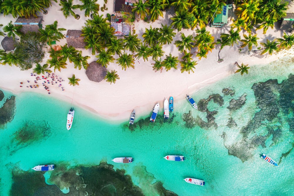 Turquoise water and white sand beach. Photo is taken from an arial view.