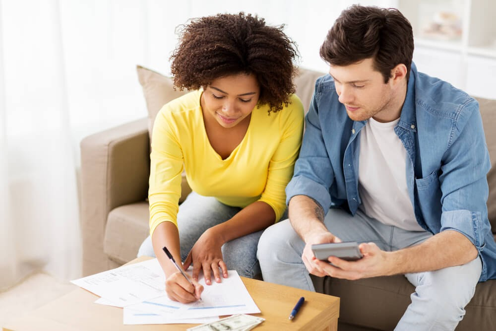 Couple sitting down doing paperwork