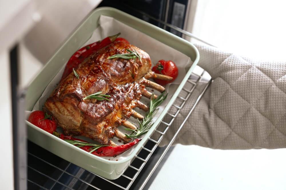Pan of entire rack of lamb roasting