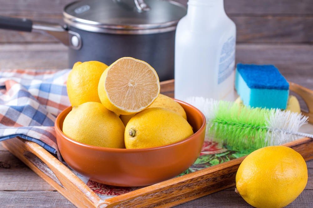 Bowl of lemons and cleaning tools.