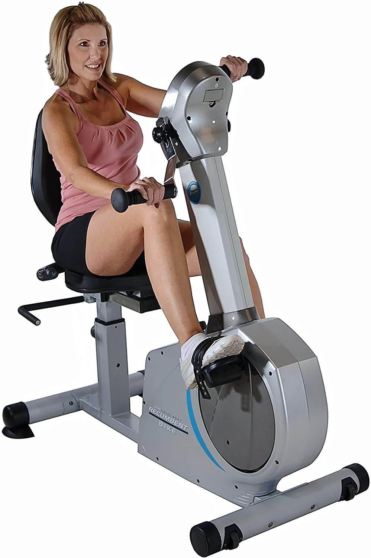 Woman on recumbent exercise bikes.
