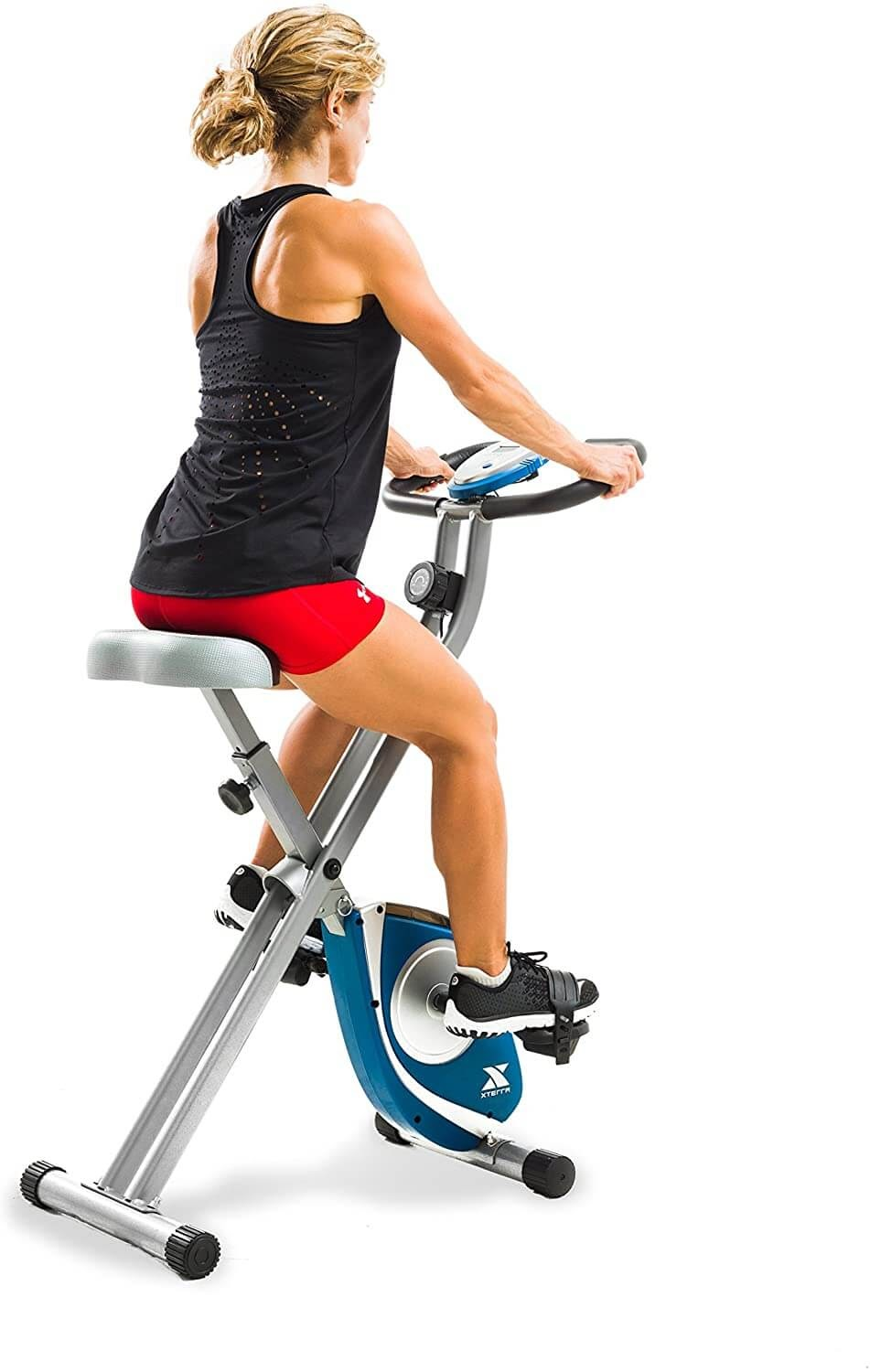 Woman from behind on exercise bike.