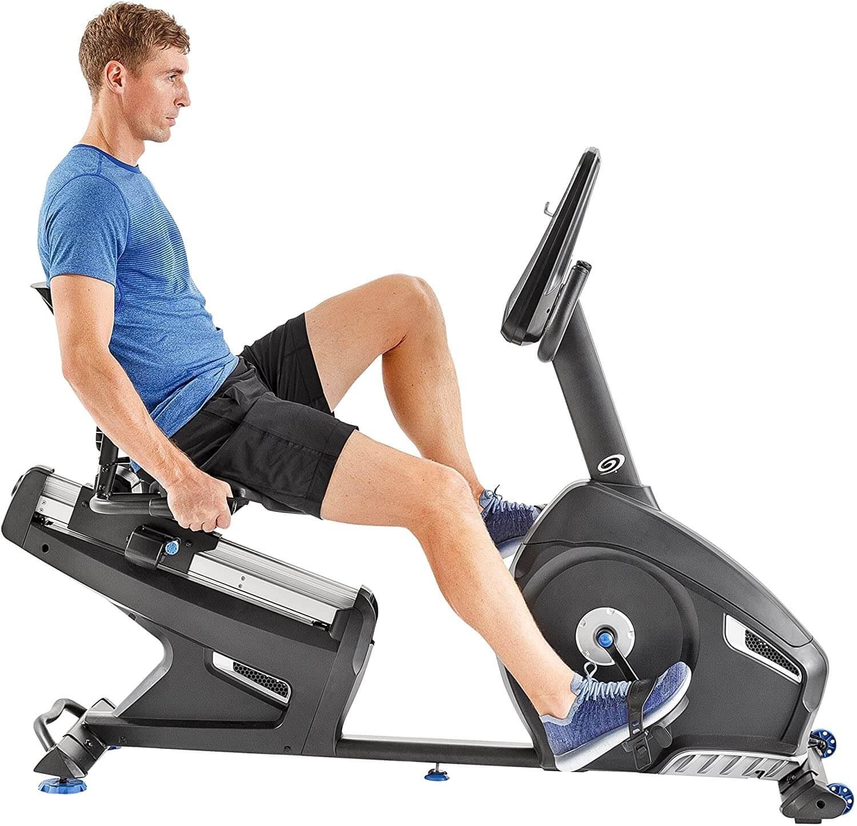 Man on recumbent exercise bike.