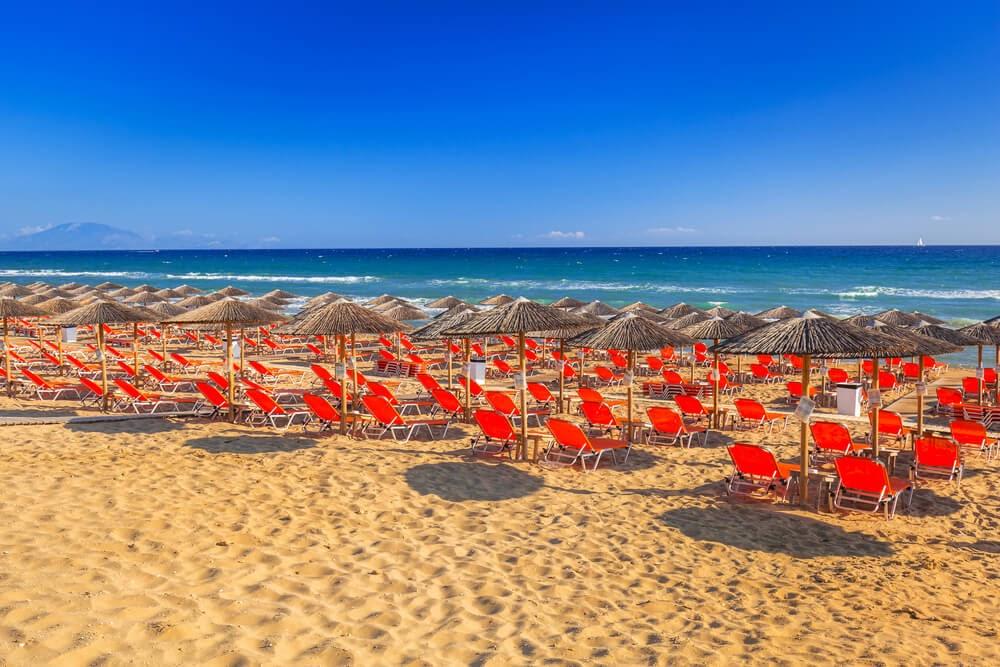 Banana Beach, Skiathos, Greece. Rows of chairs looking over the ocean.