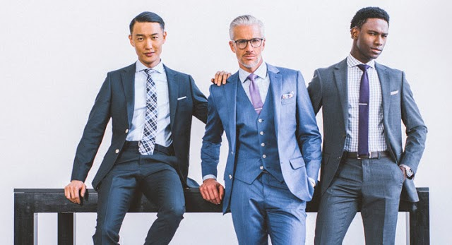 Indochino, three men in grey suits with pastel ties