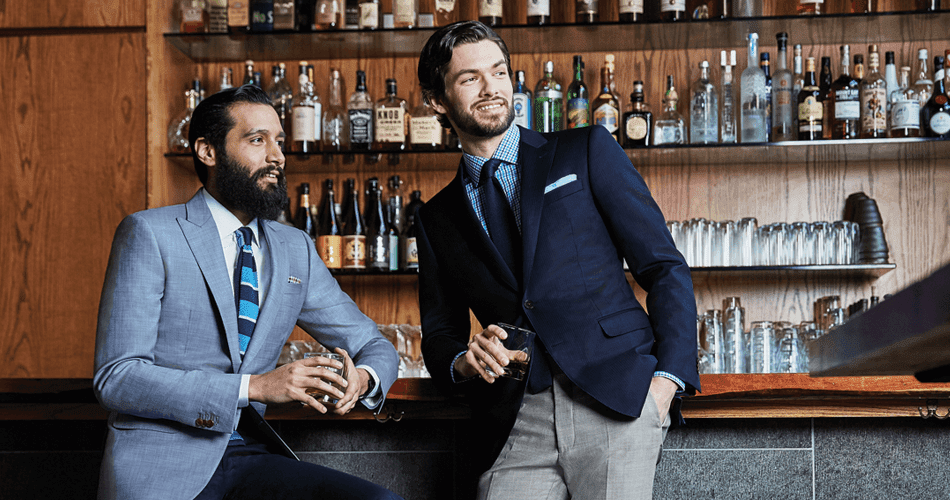 Black Lapel. two mean in suits at a bar