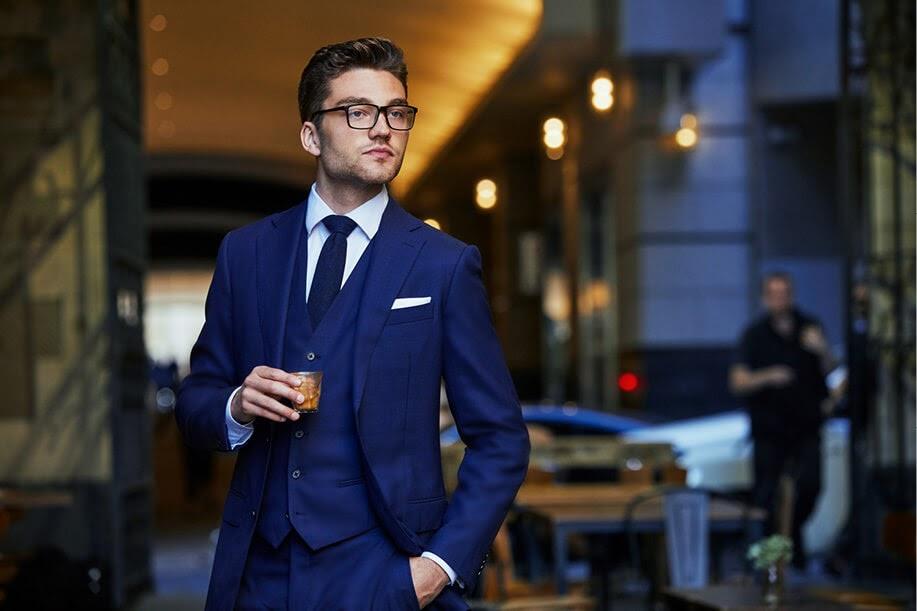 Institchu, man in a blue suit