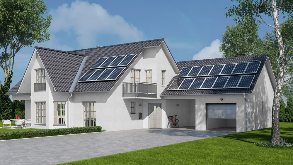Large white home with solar panels on the roof.