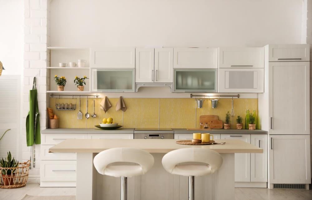 Modern white and yellow kitchen, very cheerful.