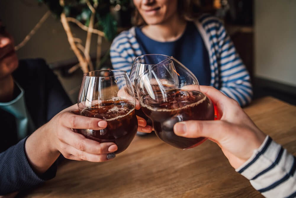Group of people drinking cold brew.