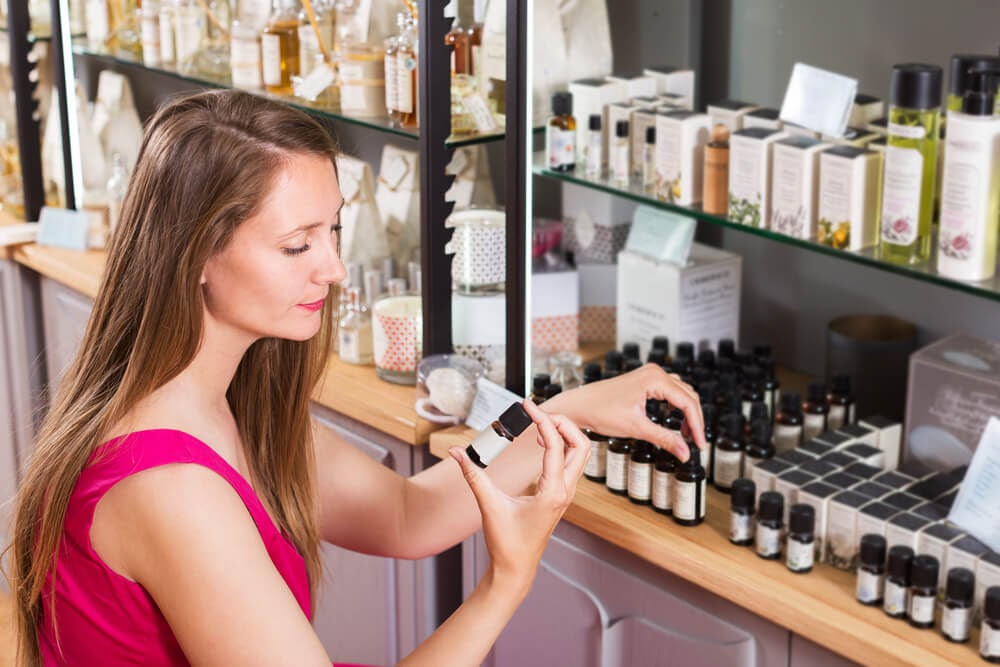 Woman shopping for essential oils