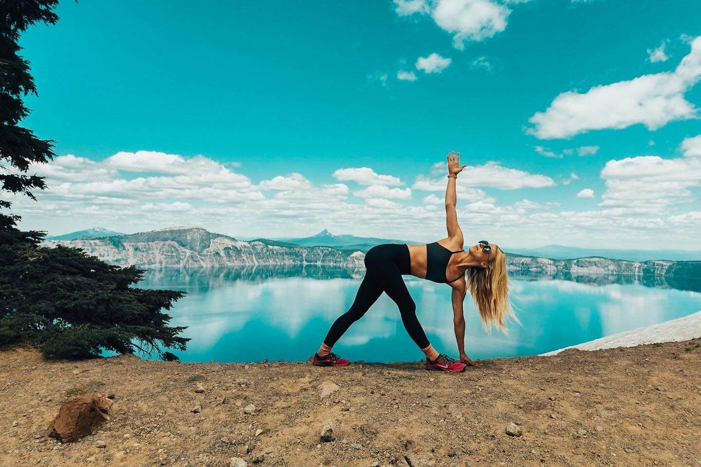 Woman doing yoga in front of Crater Lake.