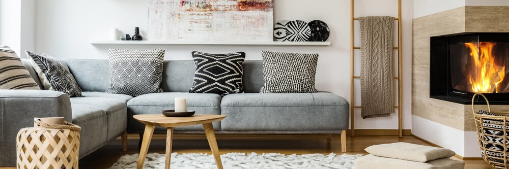 Living room with bold black and white patterns and warm wood elements