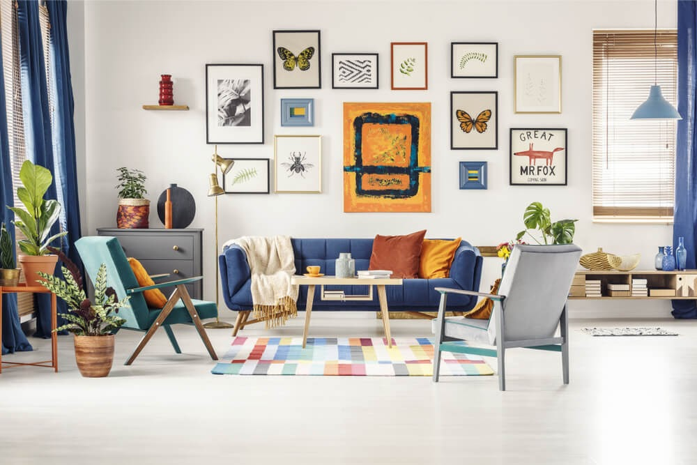 Eclectic living room design with funky wall art in blues and oranges.