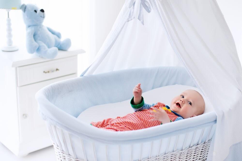 Baby in bassinet.