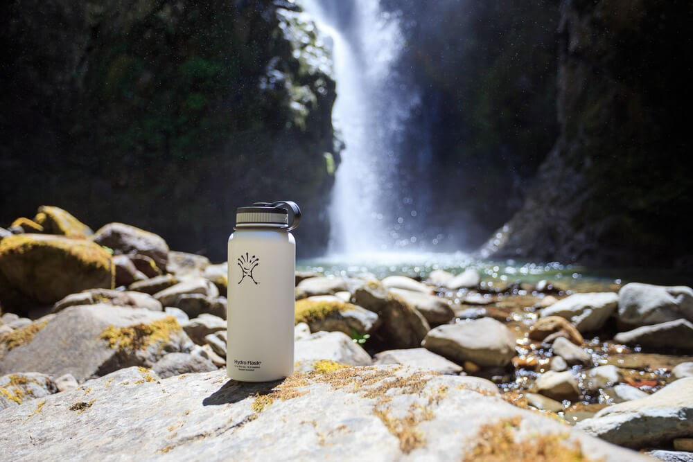 Hydroflask in front of a waterfall.