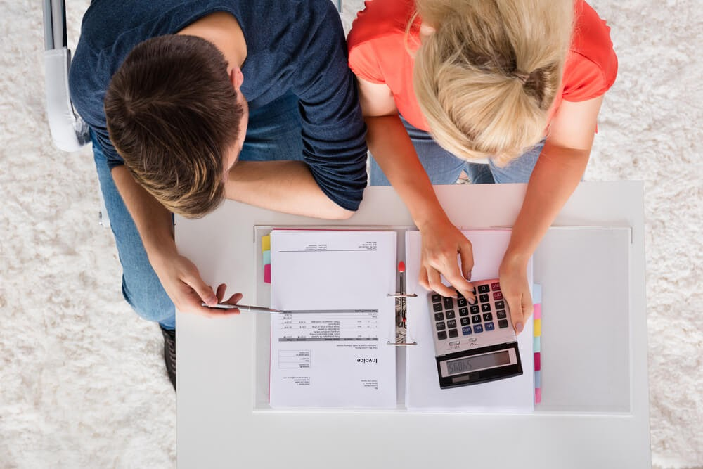 Man and woman looking over finances together