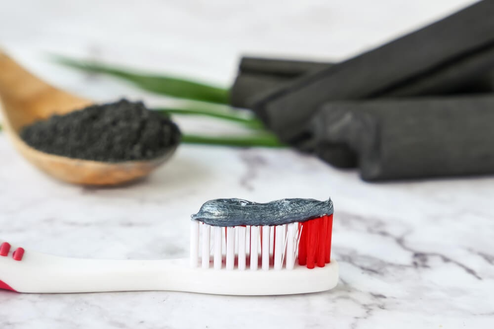 Activated charcoal on toothbrush